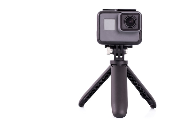 The action camera on tripod isolated on white background