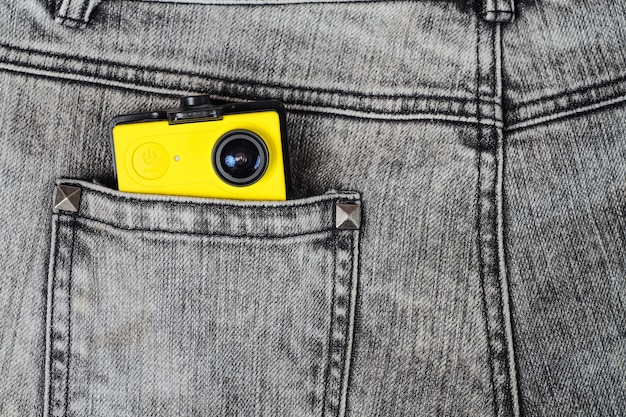Action camera in trouser jean pocket for travel.