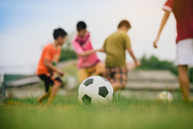 Action sport of kids playing soccer football