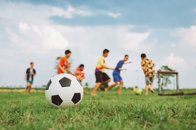 Action sport outdoors of diversity of kids having fun playing soccer football
