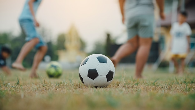 Action sport outdoors of a kids having fun playing soccer football
