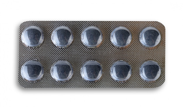 Activated charcoal (carbon) pills isolated on white background