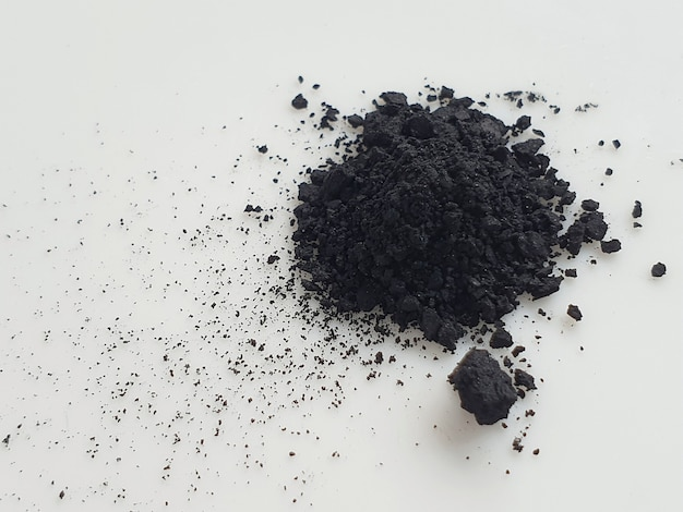 Activated charcoal powder on white