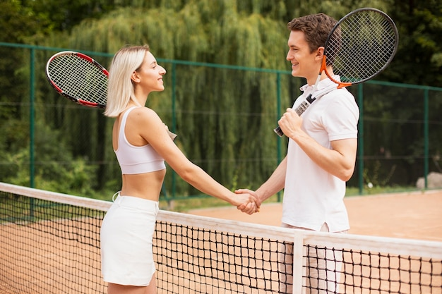 Active couple ready to play tennis