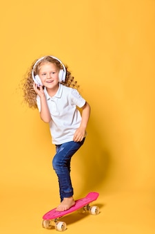 Active and happy girl with curly hair headphones having fun