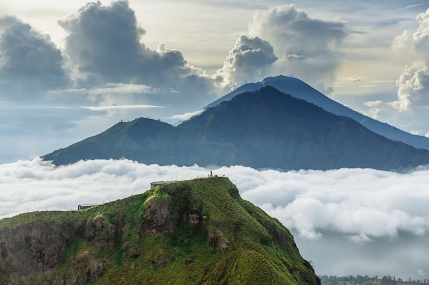 Active indonesian volcano batur in the tropical island bali. indonesia. batur volcano sunrise serenity. dawn sky at morning in mountain. serenity of mountain landscape, travel concept