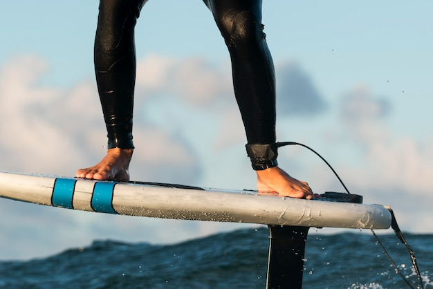 Active man in special equipment surfing in hawaii