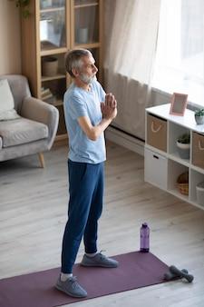 Active senior man training at home