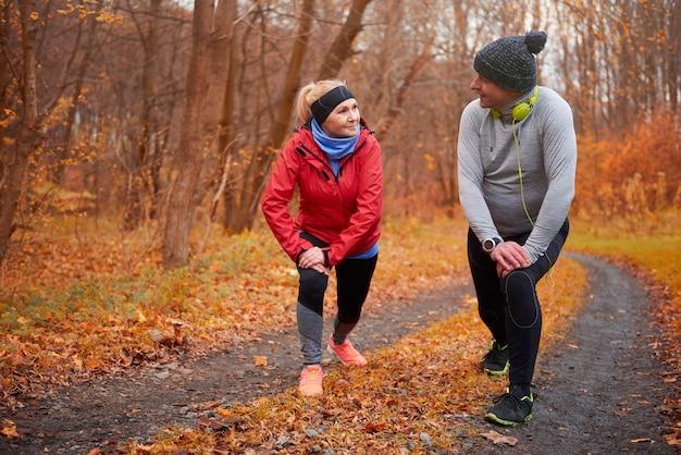 Active seniors training over autumn time