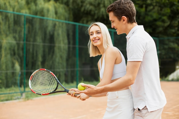 Active tennis couple exercising
