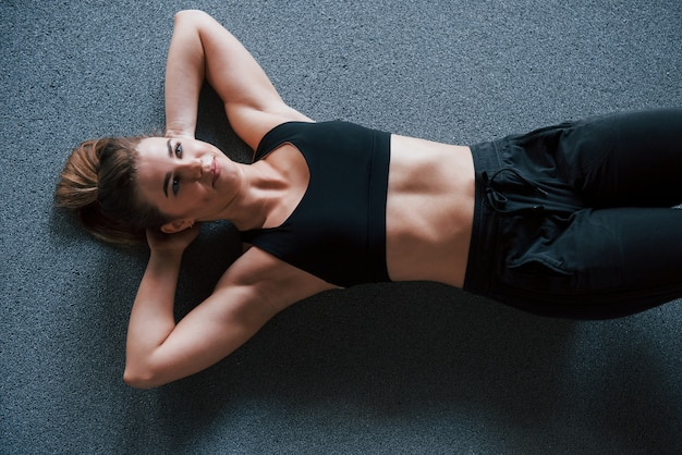 Active training. doing abs on the floor in the gym. beautiful female fitness woman