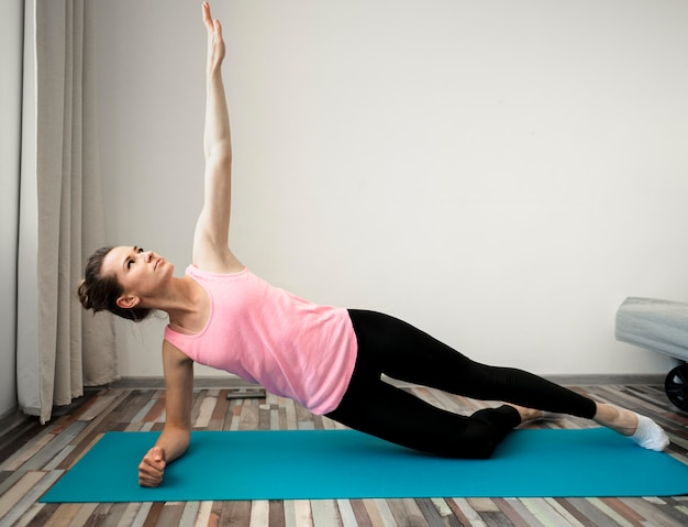 Active woman exercising at home