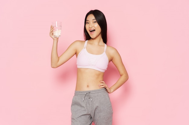 Active woman posing with a glass
