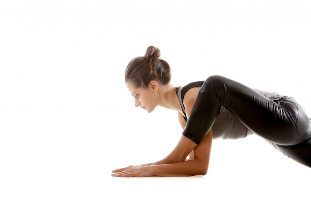 Active woman stretching her leg