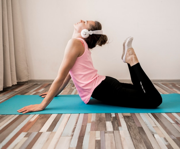 Active woman stretching at home