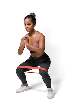 Active woman using a hip band in a squat position