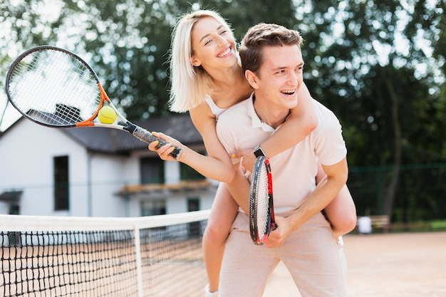 Active young couple playing tennis