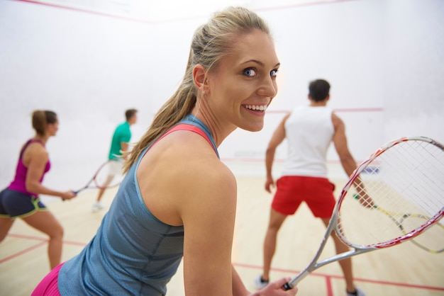 Active young people playing squash