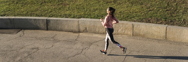 Active young woman jogging outdoor