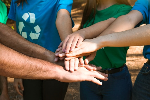 Activists hands together on team building