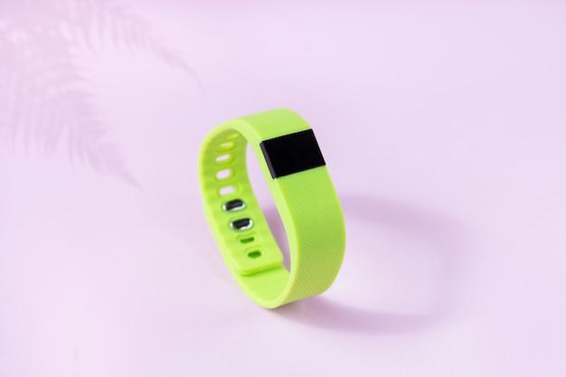 Activity smart tracker on light wall, sport bracelet
