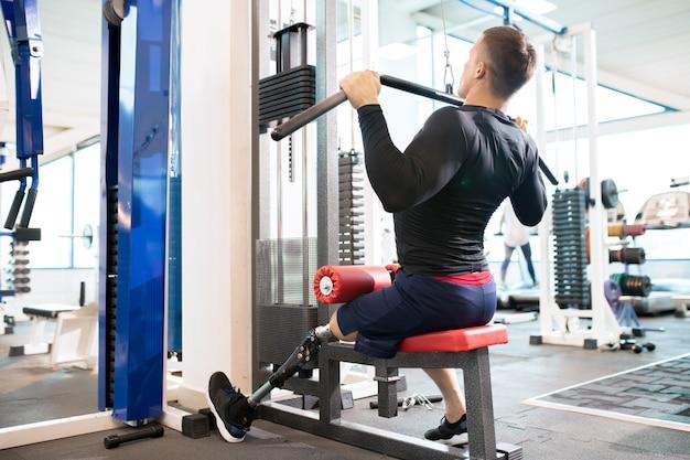 Adaptive athlete using exercise machines