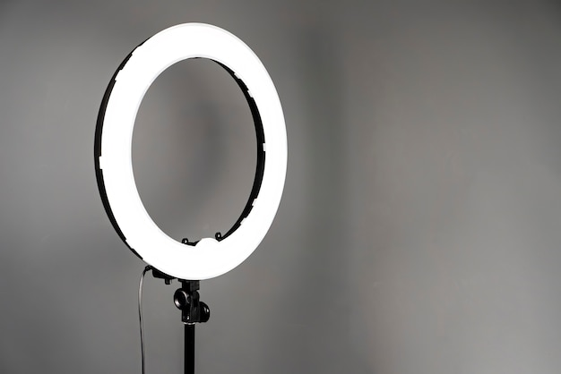Additional light in a photo studio on grey