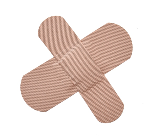 Adhesive bandage plaster or first-aid plaster isolated on white