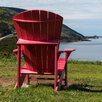 Adirondack chair at coast, petit etang, cape breton highlands national park, cape breton island, nov