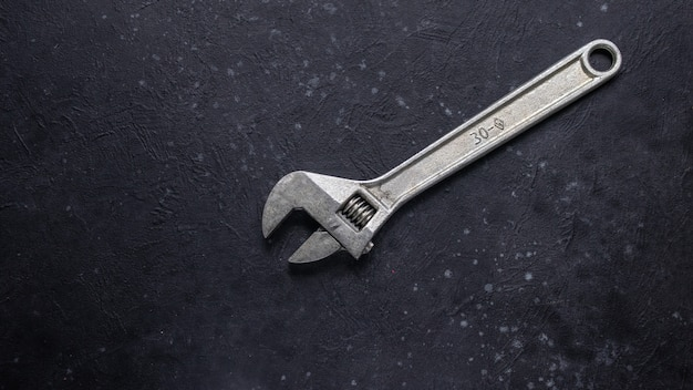 Adjustable wrench on black