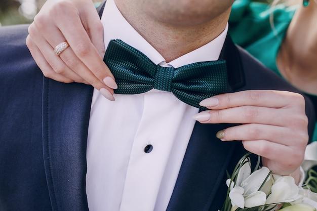 Adjusting bow tie boyfriend