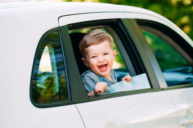 Adorable baby boy in the car