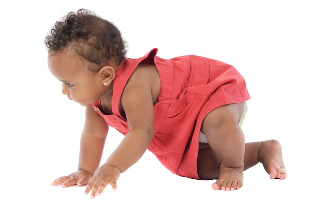 Adorable baby learning to walk a over white background