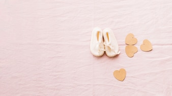Adorable baby-shoes and paper hearts