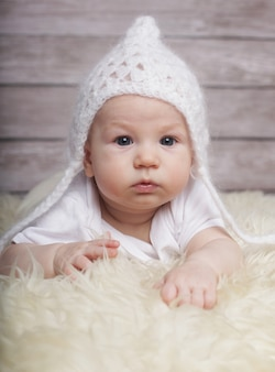 Adorable  baby in white hat
