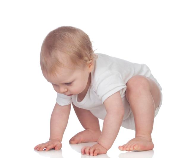 Adorable blonde baby in underwear crawling