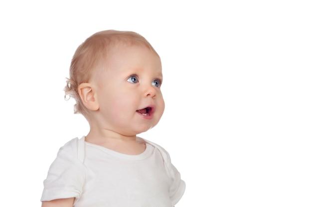 Adorable blonde baby in underwear looking up