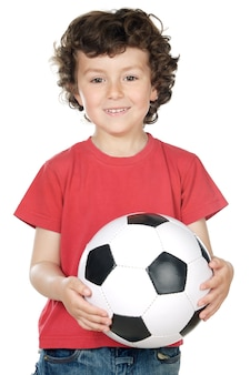 Adorable boy dreaming about being of football