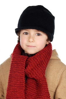 Adorable boy dress for the winter a over white background
