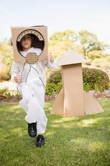 Adorable boy pretending to be astronaut