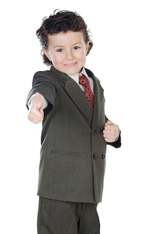 Adorable boy in a suit with thumb up