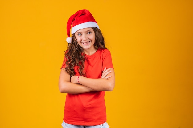Adorable child dressed as mama claus with crossed arms