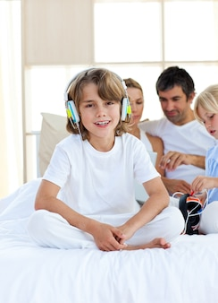 Adorable child listening music