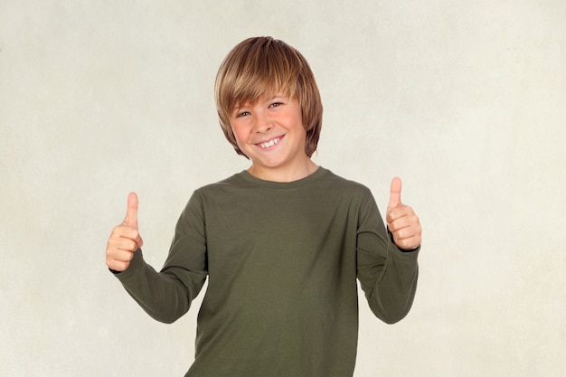 Adorable child saying ok on a over brown background