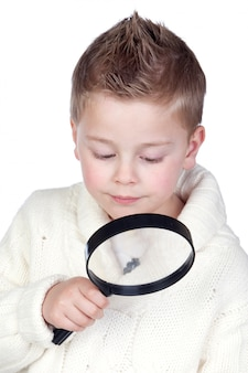 Adorable child with a magnifying glass isolated on white background