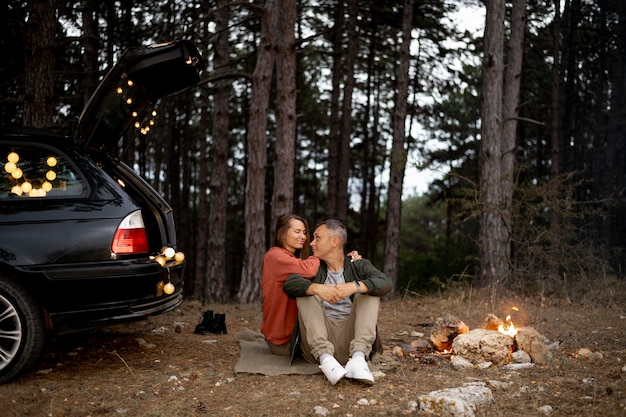 Adorable couple enjoying bonfire