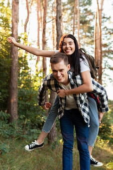 Adorable couple having fun in the woods