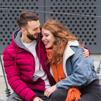 Adorable couple laughing together