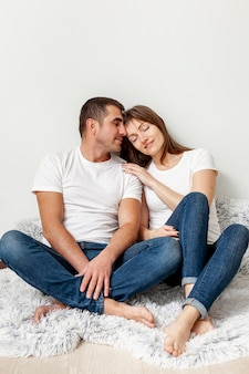 Adorable couple sitting on a blanket