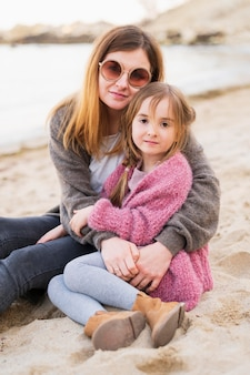 Adorable daughter and mother posing
